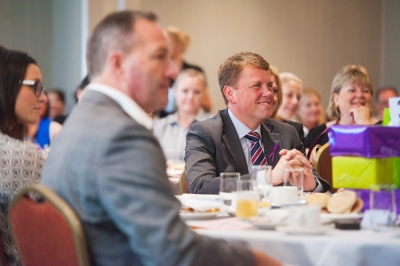 Scott Emerson MP, Minister for Transport and Main Roads enjoying QTA womens breakfast