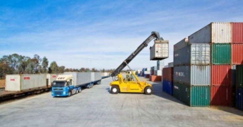 rail freight priority container being lifted by forklift