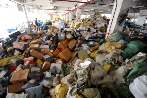 Online returns piling up in a warehouse.