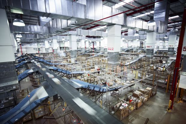 A dynamic view of the operations inside the parcel facility Australia Post online shopping