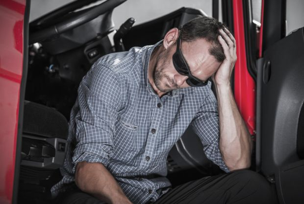 Frustrated tired truck driver Transport worker