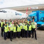 Australia Post staff celebrate the arrival of the new freighter into Melbourne Airport.